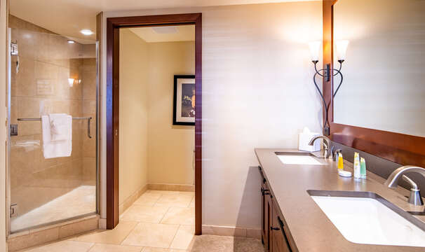 Step-in Shower & Dual Sinks in the Master Bath with Upgraded Furnishings