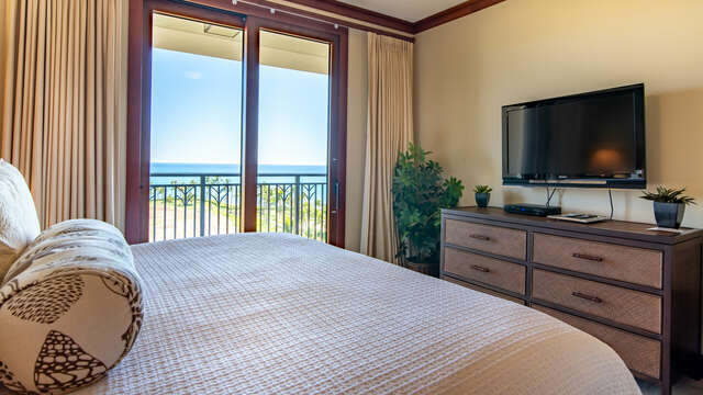 Master Bedroom with Luxury Furnishings and Flat Screen TV inside our Ko Olina Beach Rental