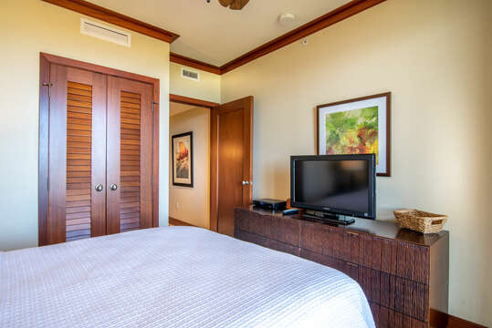 Queen Bedroom with Closet, Ceiling Fan, and Flat Screen TV in Our Ko Olina Beach Rental