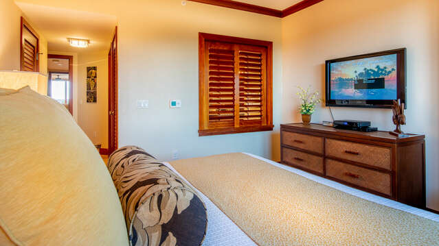 Beach Villas OT-603's Master Bedroom has a Flat Screen TV & Ceiling Fan