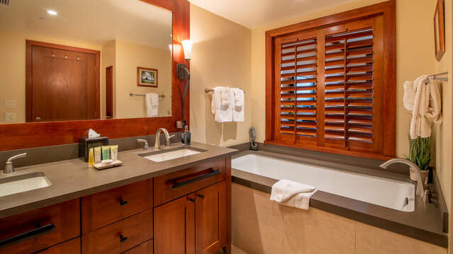 European Style Master Bath with a Walk-in Shower and a Large Soaking Tub inside this VIlla for Rent in Oahu Honolulu