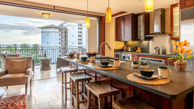 The Breakfast Bar of Beach Villas OT-603 in the Kitchen has an Ocean View Also