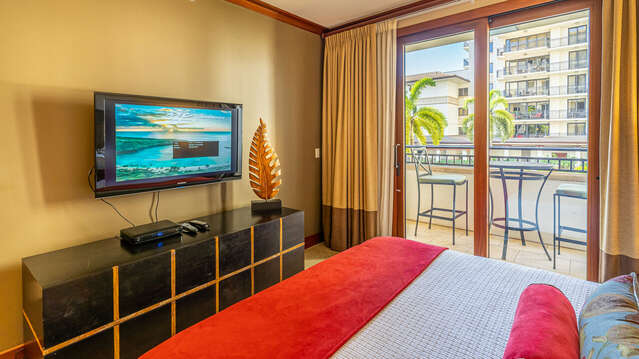 The Master Bedroom with Access to the Lanai and of course, it's own TV