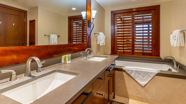 Large Master Bath of this Ko Olina beach villa in Hawaii, with a Walk-in Shower and a Large Tub for Soaking.