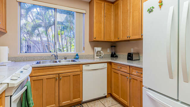 An Image of the Kitchen Features Wooden Cabinets.
