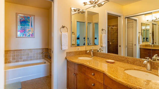 Master Bath with Dual Sinks and Shower.