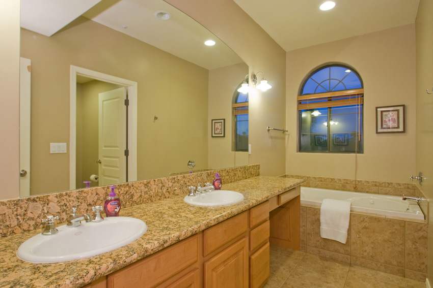 Master bathroom has dual sinks, walk in shower and soaking tub.