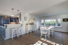 The entry reveals a quick layout of your vacation home, with formal dining, kitchen and living room all visible at a glance.