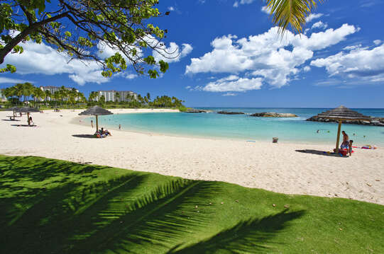Picture of the Ko Olina Lagoon, Beach Cabanas, and People.