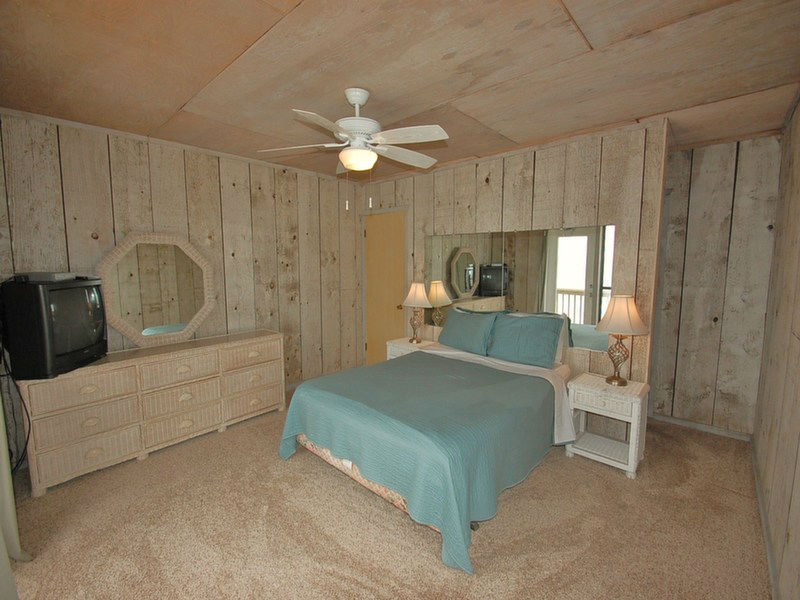 Master Bedroom with Queen Bed and Private Balcony