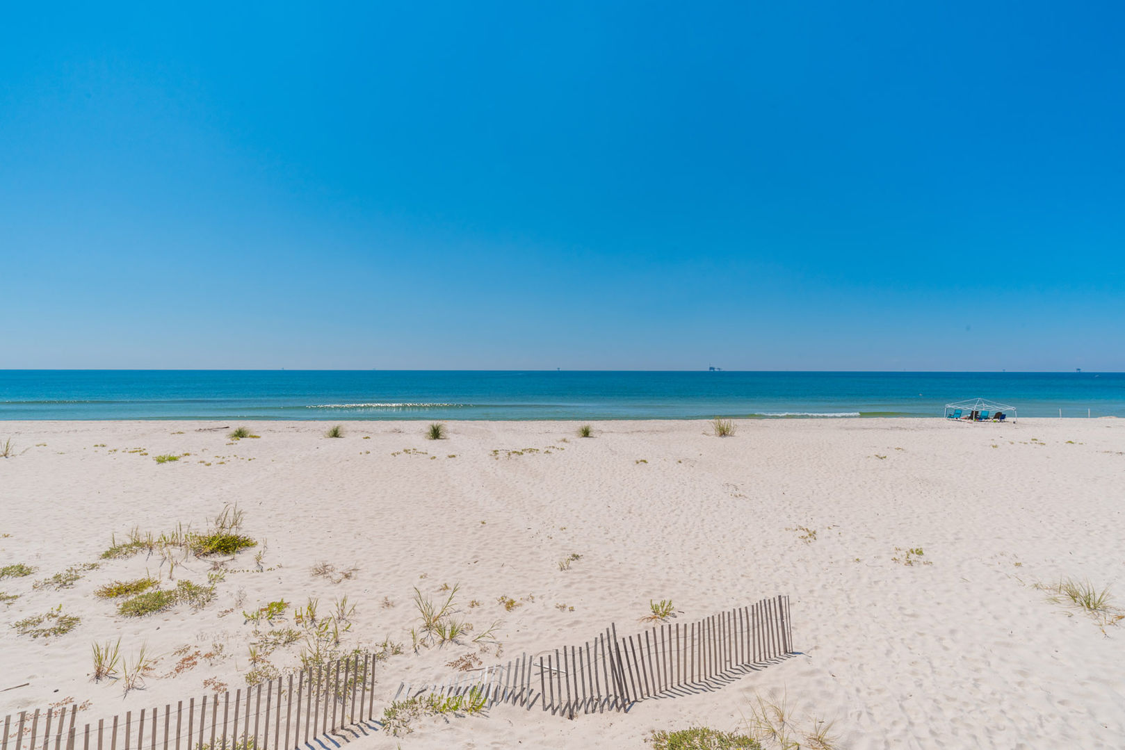 Relax and Watch the Waves Roll In from the beach near this rental.
