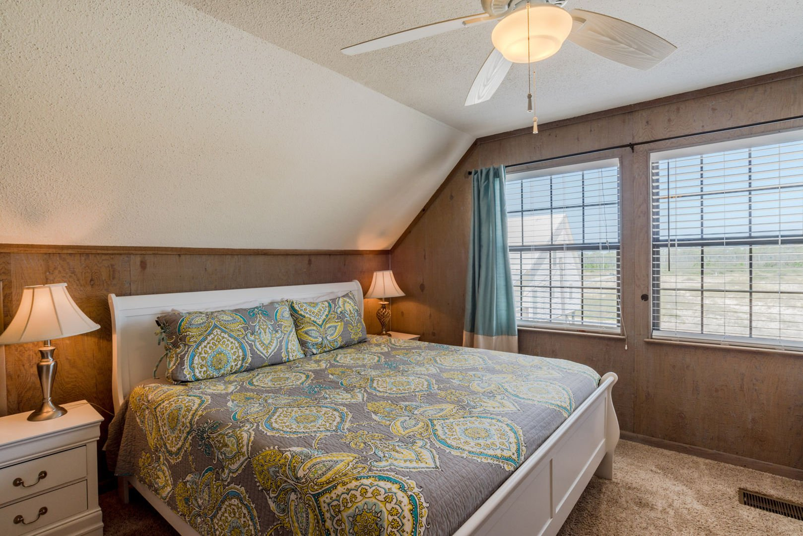 Comfortable Master Suite With North View, large bed, and twin nightstands.