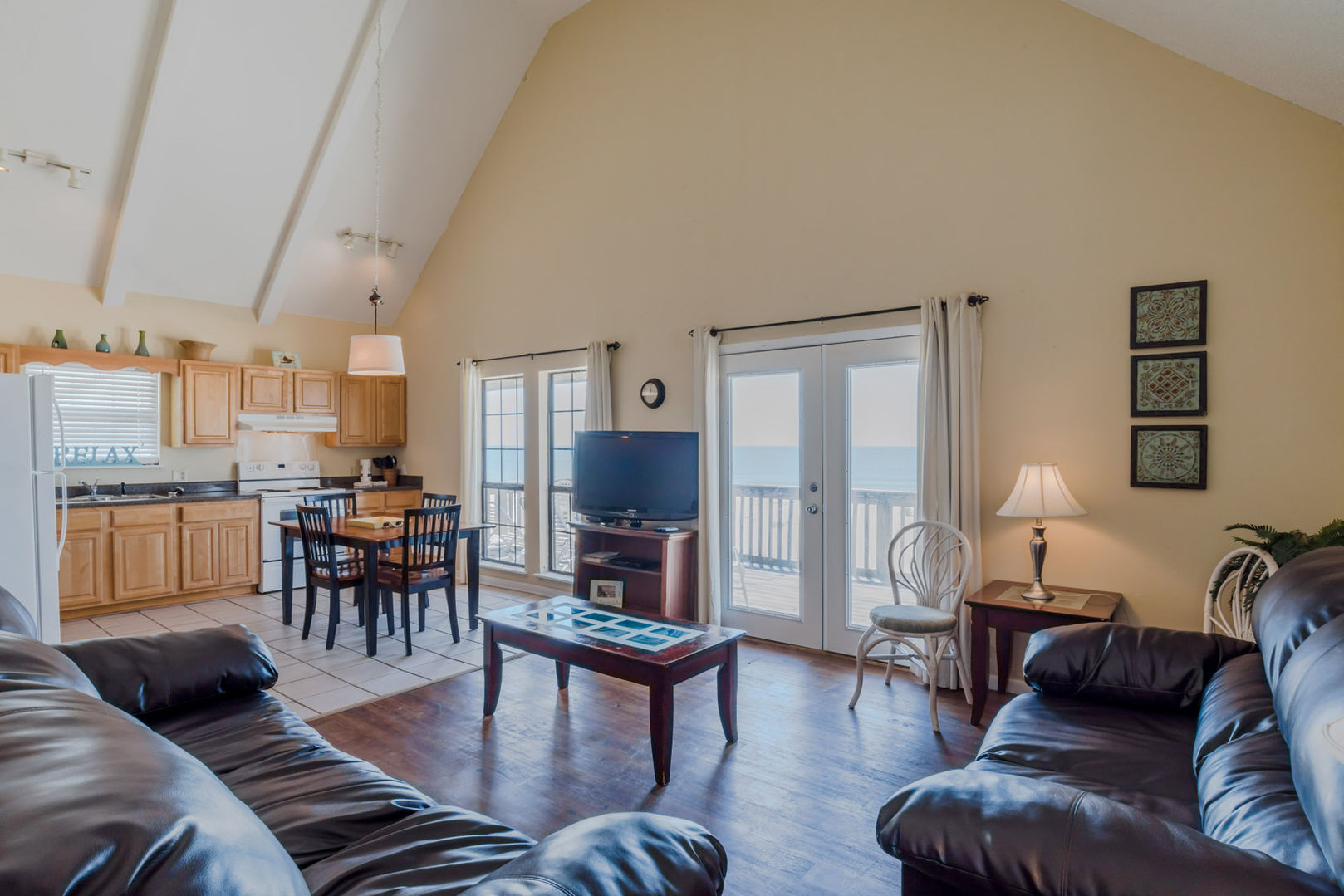 The Living Spaces of this Beach House Rental in Gulf Shores Are Open And Bright With A Vaulted Ceiling and plenty of seating