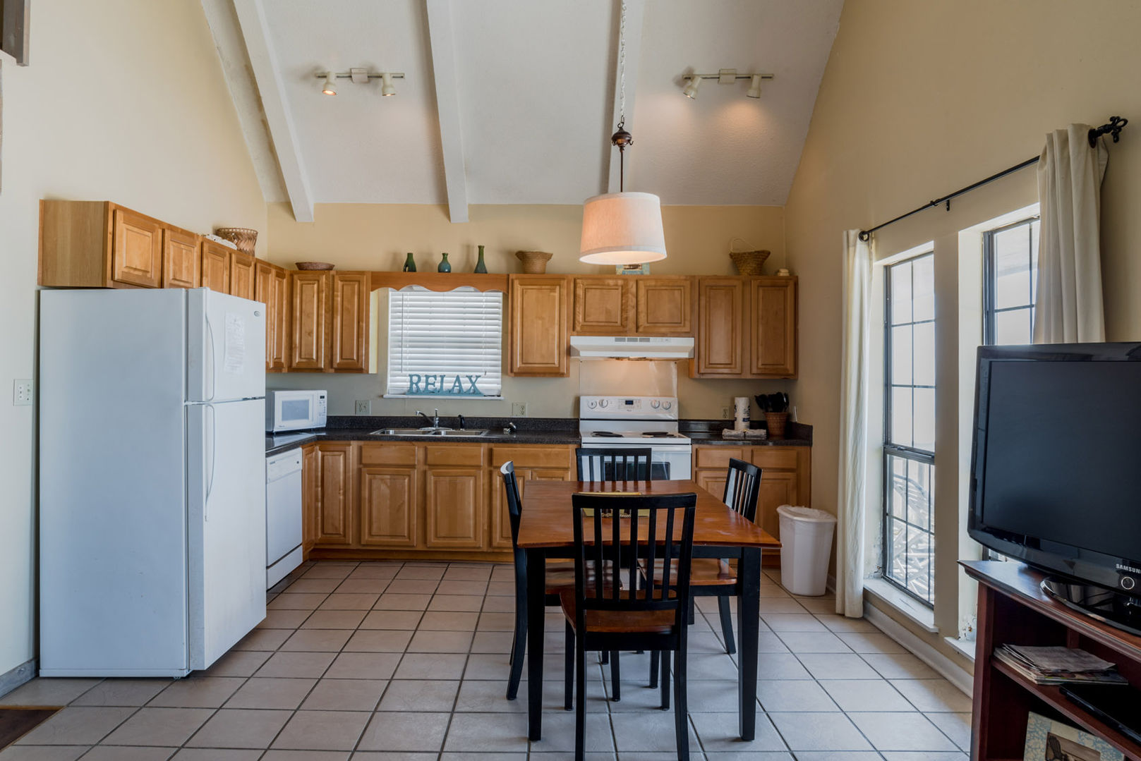 The Kitchen Is Open To The Dining Area, and complete with modern appliances and seating.