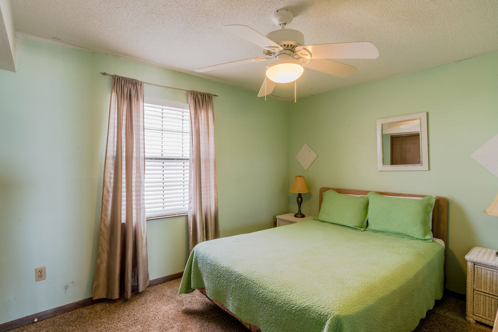 This Guest Bedroom On The First Floor Has A Queen bed, nightstands, and great lighting.