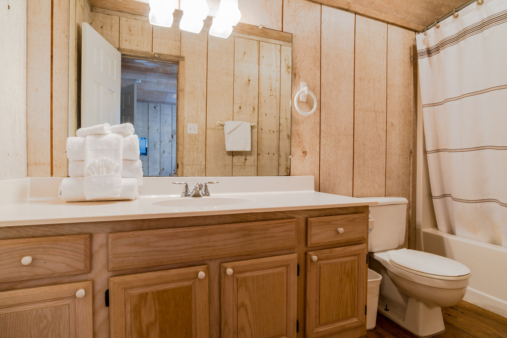 Single Vanity Sink, Toilet, and Shower-Tub Combo.