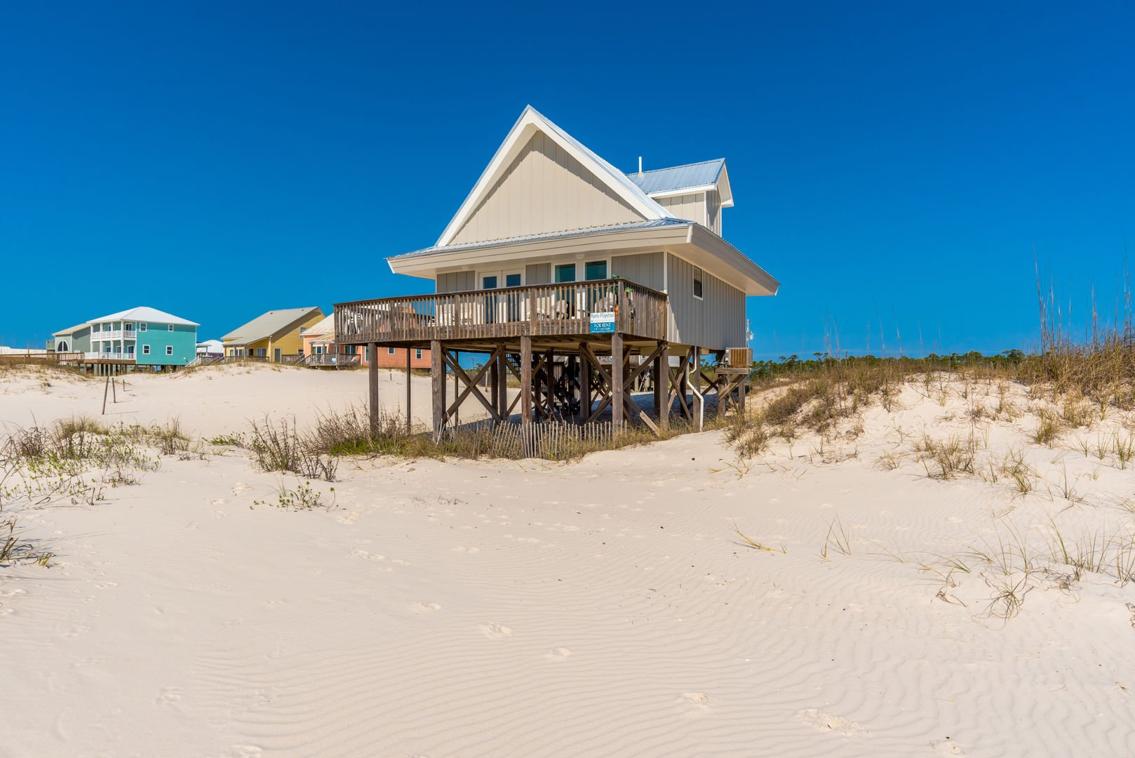 This Beach House Rental in Gulf Shores Sits Out In Front Of The Homes Nearby Offering Unparalleled Privacy