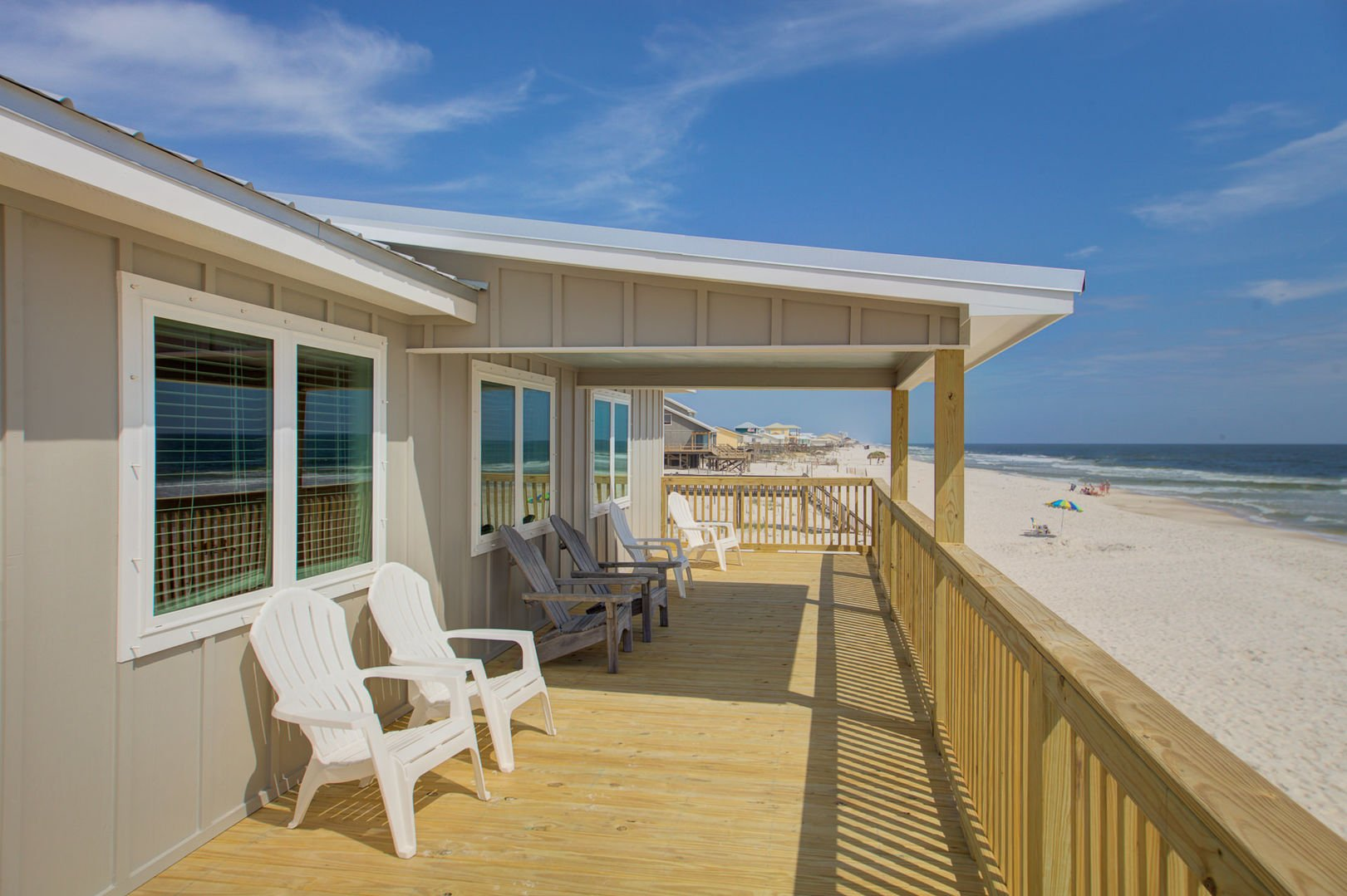 There is plenty of room to relax on the patio of this beachfront Gulf Shores rental