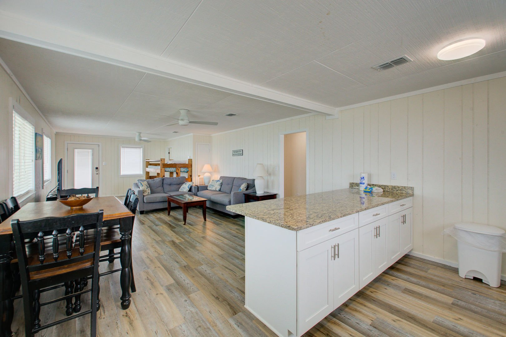 Open floor plan with living room and kitchen island