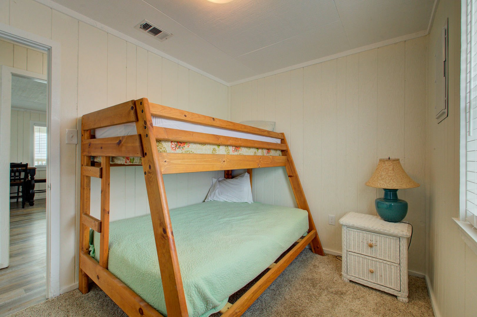Bedroom #3 sleeps 3 on a bunk bed with a full bed on the bottom.