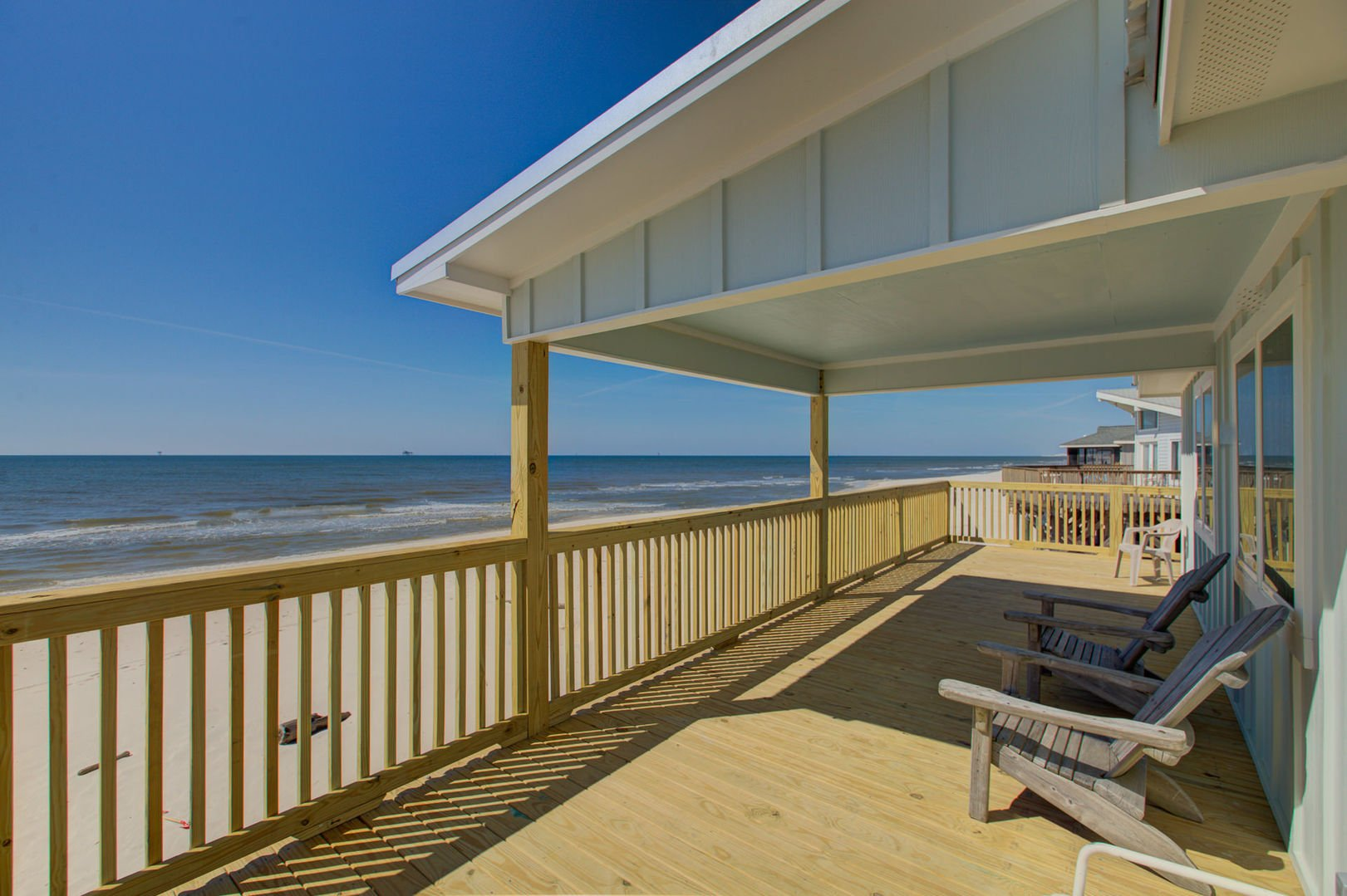 Plenty of room to relax on the porch of this Beach House Rental in Gulf Shores!