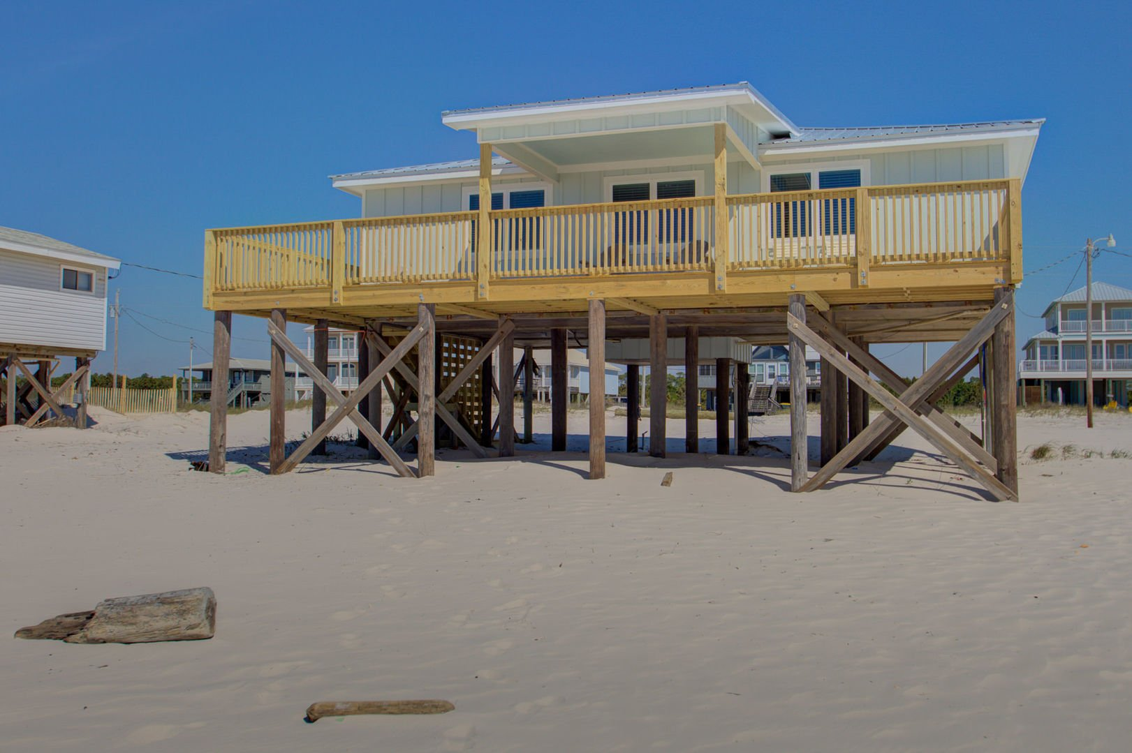 Welcome to This'll Do; picture of the front exterior of this Beach House Rental in Gulf Shores!