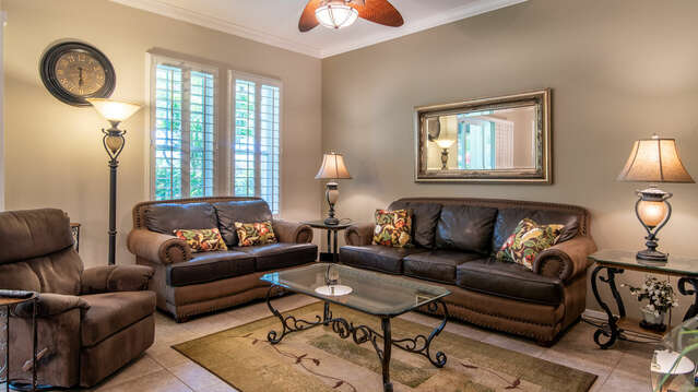 Spacious & Comfortable Living Area with Two Sofas and a Chair.