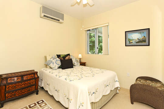 Private, Second Bedroom with a Double Bed and dresser.