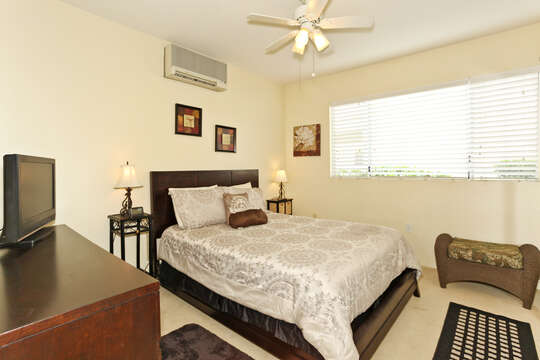 Master Bedroom of this Ko Olina condo rental with Queen Size Bed, dresser and TV.