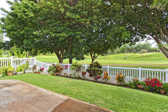 White fencing and decorative landscaping in the back yard of this rental.