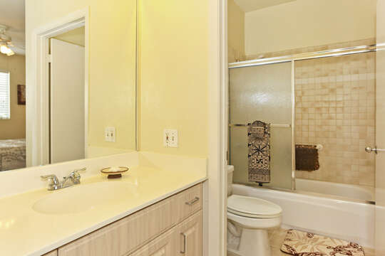 Master Bath with vanity sink, toilet, and shower with sliding glass door.
