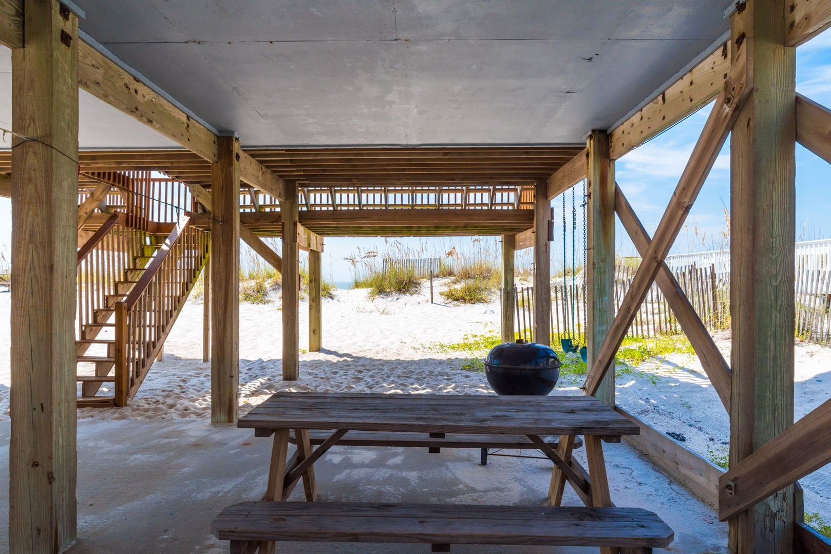 Shaded picnic area under the house with gorgeous view of the beach!