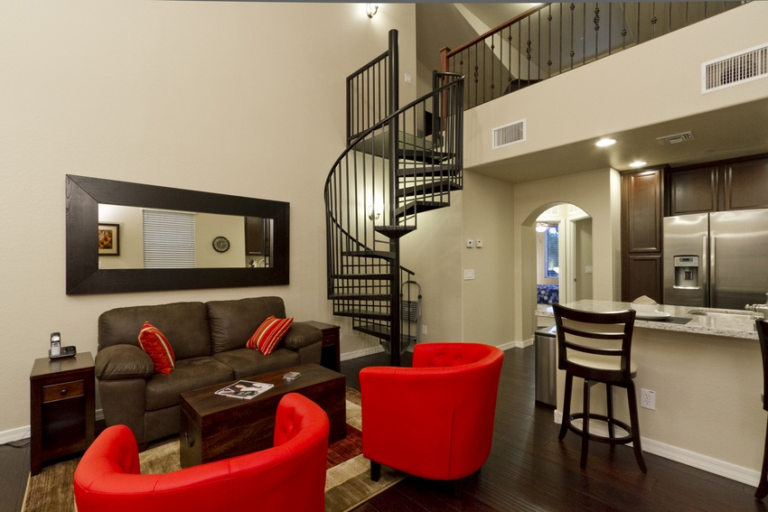 Living room loft and spiral staircase up to media loft