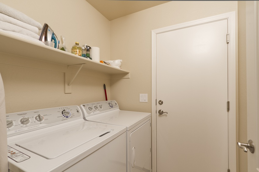 Laundry room and walkway to two car garage