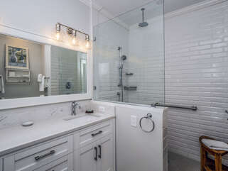 Remodeled master bath with dual sink vanity and walk in shower.