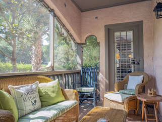 This porch is a great spot to relax with a good book or watch the golfers.