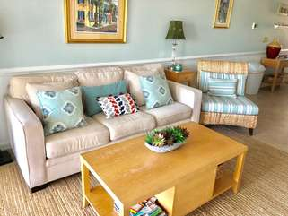 Settle in for conversation while relaxing on the new sofa (opens to a queen bed)
