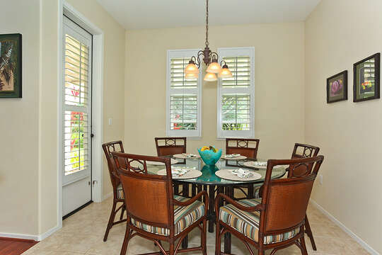 Dining Table, Chairs, Patio Door, and Ceiling Lamp.