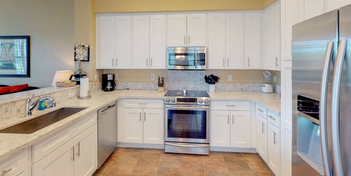 Enjoy White Cabinets and Plenty of Counter Space in Kitchen.