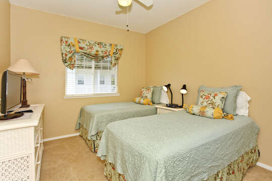 Third Bedroom with Two Twin Beds and White Dresser.