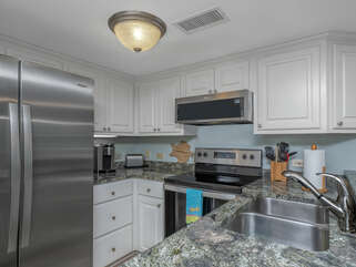 Renovated kitchen with granite counter tops.