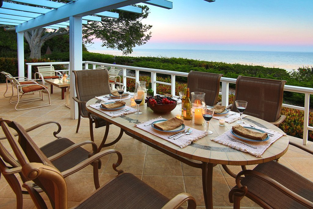 Dining and sitting area on oceanside deck