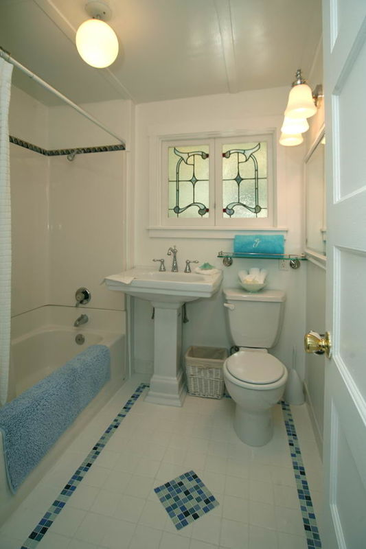 Bathroom featuring antique stained glass window
