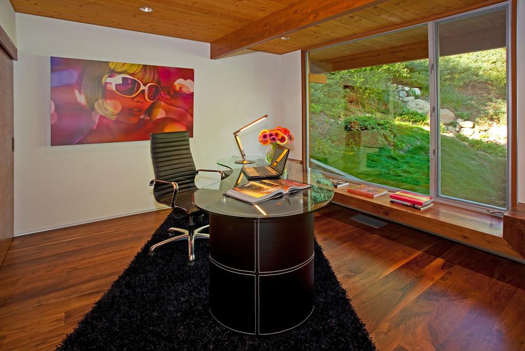 Office faces hillside and seasonal creek