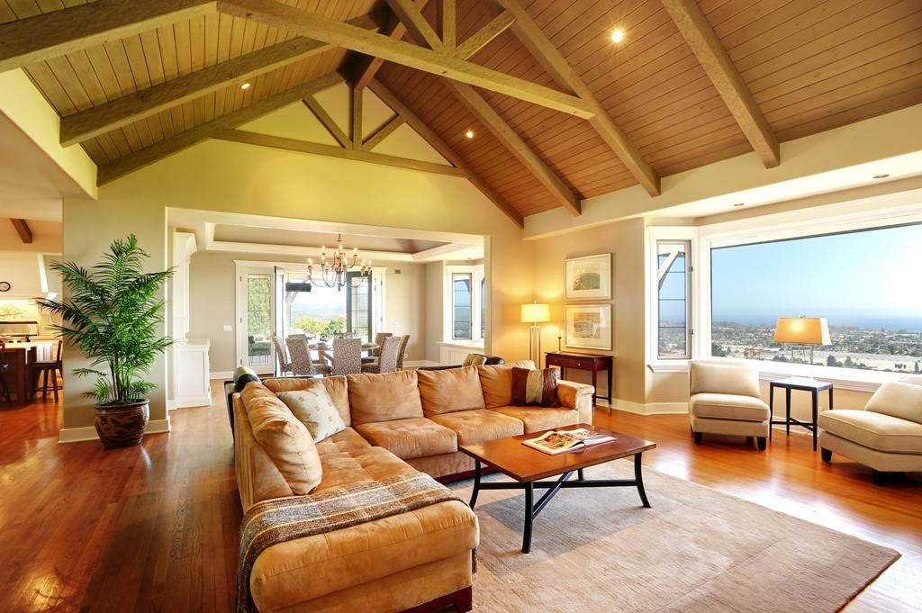 Comfortable fireside Living Room under truss beams