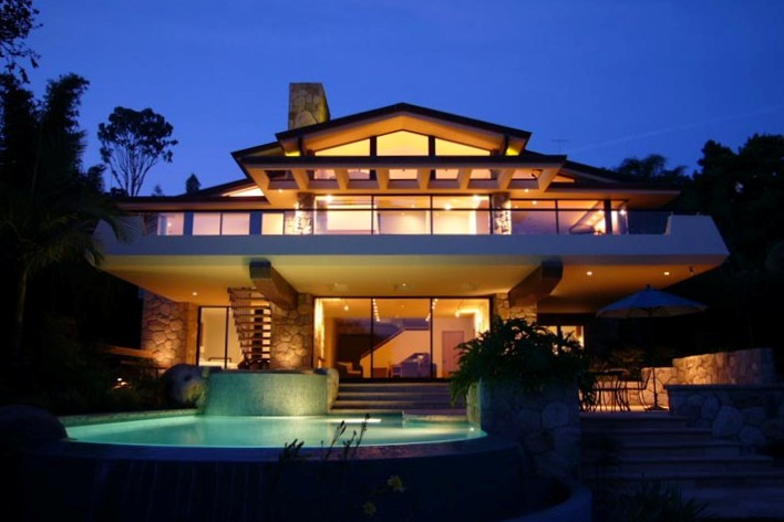 Cantilevered balcony overlooks pool and spa