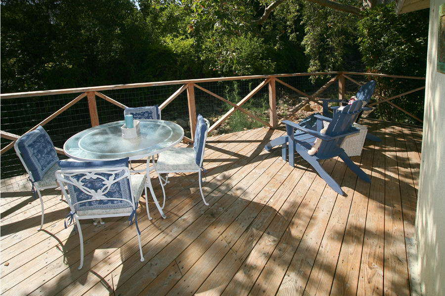 Rear deck overlooking secluded natural creek bed