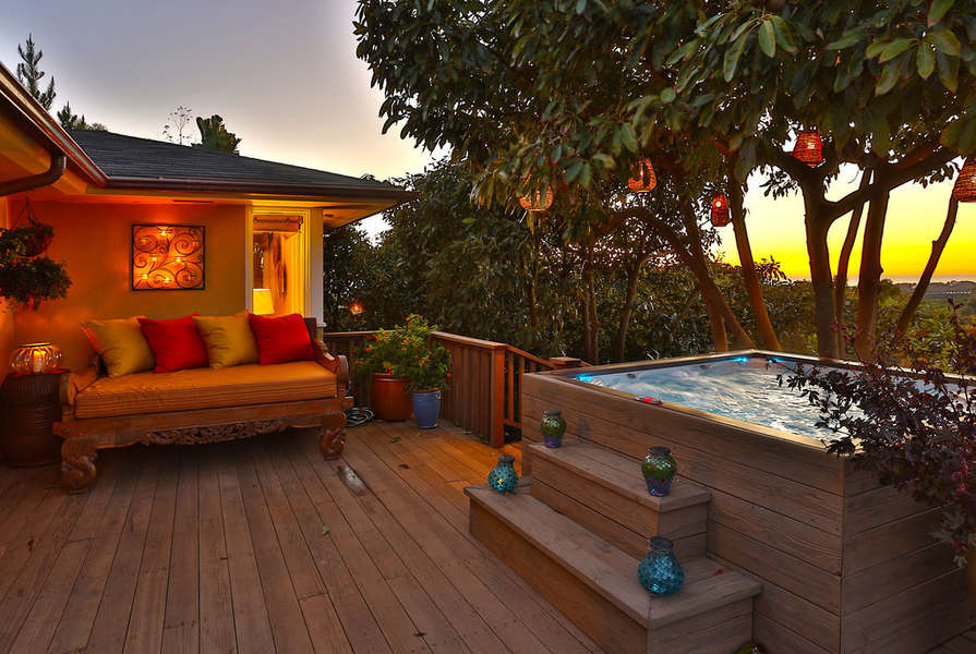 Enjoy the hot tub and day bed on the deck