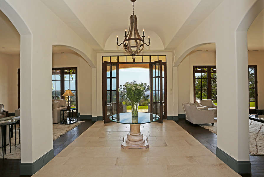 Entry between two elegant Living Rooms