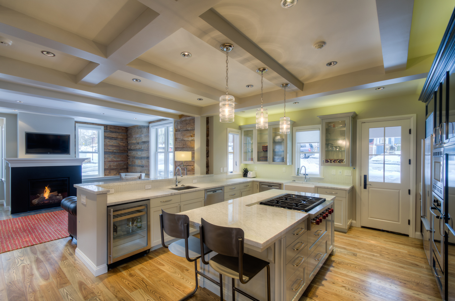Kitchen with Bar Seating, Gas Stove, and Wine Fridge at Miles High